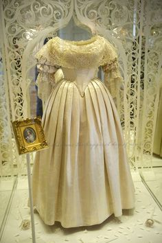 Wedding bells: Queen Victoria's dress from her wedding to Prince Albert in 1840. The Honiton lace over-skirt had been removed to be used in another dress, but the lace on the neckline and the sleeves remain.