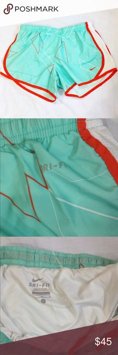 Nike Dri-Fit Shorts in Mint/Orange Size L. Mint green with orange and white geometric detailing. Great condition. Make me an offer! Nike Shorts