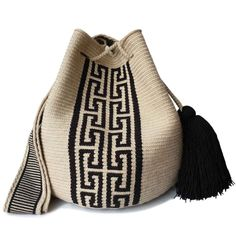 The stunning, one-of-a-kind Wayuu bag has been carefully crocheted by indigenous women from the desert of La Guajira, Colombia. Tapestry Bag, Tapestry Crochet, Mochila Crochet, Handmade Bags, Beautiful Bags, My Bags, Bag Making, Bucket Bag, Hand Weaving