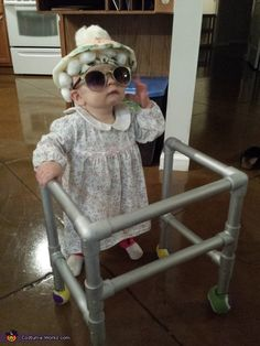 Naomi: My daughter is 10 months old and dressed up as an old lady. Made the walker and outfit myself.