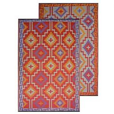 Lhasa Outdoor Rugs are made of Recycled Plastic.  We love the colors and the graphics! homeinfatuation.com