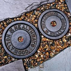 Awesome idea!!  These are free weights from the gym incorporated in to the garden path.....I luv this!