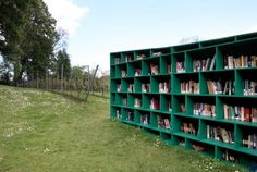 The outdoor library entitled Bookyard was built by Italian artist Massimo Bartolini for the Belgian art festival TRACK: A Contemporary City Conversation in Ghent. Visitors are invited to peruse the stacks and are free to take any book they find