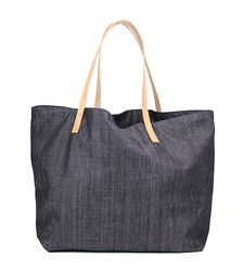 We love this easy denim tote bag for work, school, market, or holiday. Perhaps it would be simpler just to use it every single day. Light and comfortable, but large enough for a man to carry without looking silly. With natural leather handles that will darken and soften up with use. With pockets inside for pens, phone, keys, etc.   Made in USA.