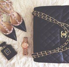 Valentino Rockstud pumps and black Chanel handbag for timeless elegance.
