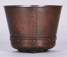 Extremely rare Roycroft hammered copper jardiniere with riveted construction and three feet. Signed with early mark. 10″h x 12.5″d