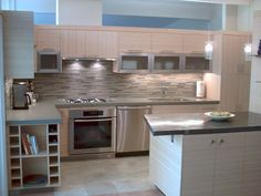 Bamboo Kitchen Remodel, dining side, finished 2008. Miele oven, stove top, pull out range hood and dishwasher.