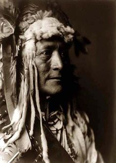 White Duck, a Hidatsa Warrior. It was created in 1908 by Edward S. Curtis.    The photo illustrates this Hidatsa Indian posed and wearing a headdress.