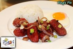 Longganisa is the Philippines native sausage, the sausages are flavoured with indigenous spices, with each region having its own specialty. Among others, Lucban in Quezon Province is known for its garlicky longanizas, while in Guagua Pampanga Province for its salty, almost sour, Longganisa.  The famous breakfast dish for Longganisa is Longsilog stands for  Longganisa, Sinangag and Itlog.