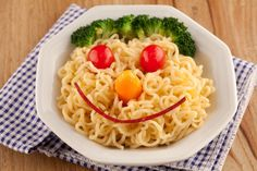 Happy Face: broccoli, tomato balls, mini bell pepper, top roman noodles (Other ideas here)
