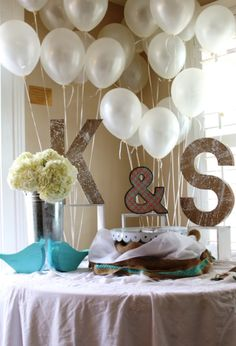 Shabby chic love birds cake table with bride and groom's initials. Decor by Imprint Affair.
