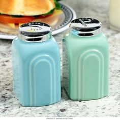 The '50s Salt and Pepper Shakers will sprinkle the unique flavors of the 1950s into your kitchen! With modernist stylings and blue and green pastel coloring, these art deco style shakers will spice up your decor whether it's retro themed or today themed! Set of 2. Each measures 2.25