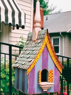 Painted birdhouse with stripes