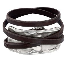 Bracelet with brown leather bands and silver-plated metal piece. Characteristic of UNOde50, 100% handmade in Spain