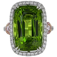 14.63 Carat Cushion Cut Peridot Pink White Diamond Ring | From a unique collection of vintage cocktail rings at https://www.1stdibs.com/jewelry/rings/cocktail-rings/