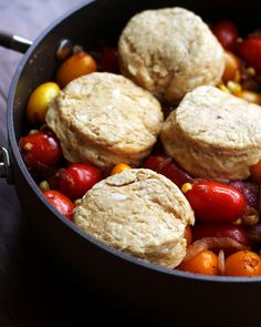 A savory cobbler topped with cheddar buttermilk biscuits and filled with chipotle-roasted cherry tomatoes, fresh sweet corn, and delectable caramelized onions – it is sure to be the hit of whatever party you bring it to!