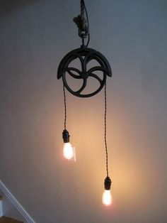 I made this lamp for my basement, pulley was from our old barn