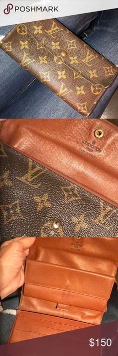 Tri- fold Louis Vuitton Wallet Definitely pre-loved but still has a lot of life left Louis Vuitton Bags Wallets