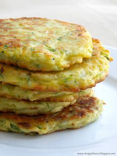 Shopgirl: Zucchini Patties  2 cups grated zucchini (one medium sized zucchini) 1/2 small onion, finely diced 1 large egg 1/4 cup grated Parmesan cheese 1/2 cup all-purpose flour Salt and Pepper Olive oil *You could add garlic or herbs for some extra flavor