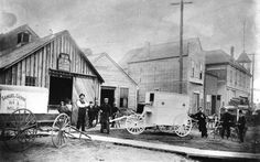 The first ambulance built by Thomas Lobb in front of his blacksmith business on Westminster Road (Kingsway) near Westminster Avenue (Main Street), and showing W. D. Muir Grocery in what would become the foot of KIngsway at Main, ca 1897.