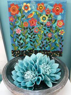 cuadros y centros con flores en tonos turquesa en www.virginia-esber.es