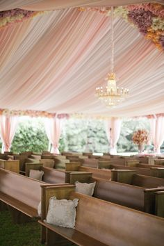 church pews at an outdoor ceremony