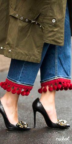 Red Pom Pom Hems on a Pair of Jeans at Milan Fashion Week // More Winter Style Ideas from the Best MFW Fall 2016 Street Style: (http://www.racked.com/2016/2/25/11112352/mfw-fall-2016-street-style)