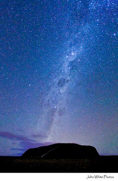 Milky Way. Looking south over Uluru. Central Australia. John White Photos