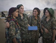 Members of Kurdish People's Protection Units (YPG) converse on August 11, 2015. (Photo: Kurdishstruggle) Kurd-organized radical inclusivity winning against extremists in Syria and the middle east.