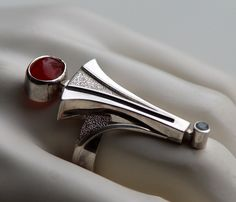 Ring | Rimantas Brusokas.  Sterling silver, carnelian and blue topaz.