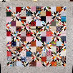 Hunter's Star variation, using HST's. Easy to construct. Consists of 8 half-square triangles and 2 squares. Great scrappy look shown here.
