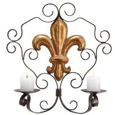 Showcasing artful design with a touch of whimsy, this beautifully crafted piece adds a captivating focal point to your home d�cor.   Product: SconceConstruction Material: Cast ironColor: MultiFeatures: Elegant fleur de lis motifAccommodates: (2) Candles - not included Dimensions: 13.5 H x 14 W x 5 D