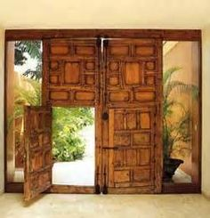 Wonderful wooden doors! Like the glass being on either side as well.