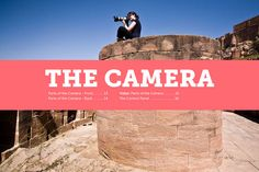woman on top of hill shooting with camera