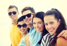 group of friends having fun on the beach stock photo (c) dolgachov (#4353885) | Stockfresh