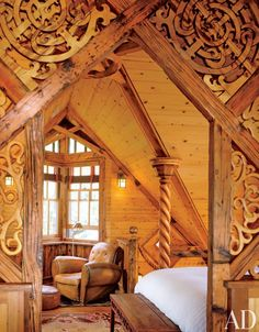Designer Bryan Anderson referenced Victorian Art Nouveau Celtic Viking and Maori design in this Norwegian-style boathouse in Colorado including this upstairs bedroom and sitting area. Casa Viking, Viking House, Architectural Digest, Viking Decor, Celtic Decor, Art Nouveau Bedroom, Basement Master Bedroom, Norwegian Style, Norwegian House