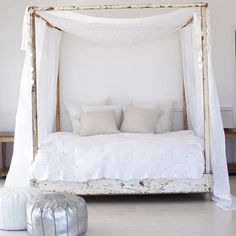 All white bedroom, whitewash four poster bed, silver pouf