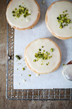 Frosted orange cookies with pistachios.