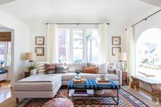 Celebrate endless summer vibes by touring this warm, eclectic family home at the beach. Love the tie dye ottoman