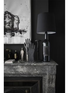 dark living room mantel vignette shot by romain ricard for elle decoration // via coco+kelley