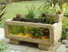 These are wicked cool! And I totally want one for our house! :) Elmdene PA300 Patio Aquarium | Tips For Home