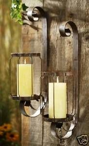 rustic candle sconces these would work well on the wall in the screen room