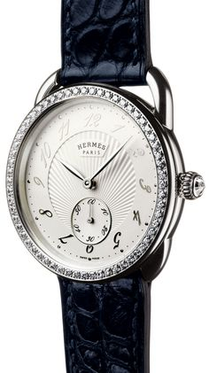 Hermès Arceau Ecuyère, 34 mm diameter 316L steel set with 60 diamonds (0.7ct), Crown set with a rose cut diamond at 0.07 cts.  | The Jewellery Editor