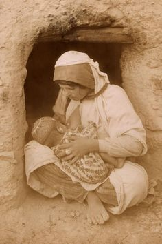 For Mother's Day, see how moms have cared for their children for the last 100 years.