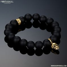 Our Smooth Matte Black Onyx & 18kt. Gold Skull Charm Bracelet Adorns The Wrist Perfectly, The Smooth Texture Of The Stones Beautifully Contrasts The Gold Tones Of Our Handcrafted Skull Design, Each Eye Of The Skull Is Set With A Precision Cut Black Swarovski Crystal Creating A Perfect Blend Of Style & Sophistication | Available Now At Northskull.com [Worldwide Shipping] #northskull #Jewelry #bracelet #gold #skulls #swarovski #luxury