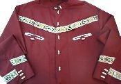 """Mexican Cowboy measuring 18"""" across the chest. The shirt is maroon with embroidery and features unusual buttons. The garment is long sleeved and was imported from Mexico. The manufacturer is Sotres. The shirt is in mint condition."""