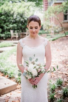 Bride looking down at her bridal bouquet at this wedding at The Venue Chattanooga by Chattanooga Wedding Photographer, Amanda May Photos.