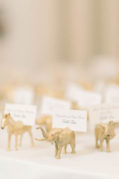 Gold animal escort cards: http://www.stylemepretty.com/washington-dc-weddings/2016/03/07/classic-black-white-d-c-wedding-ballroom-wedding-with-pops-of-pink/ | Photography: Elizabeth Fogarty - http://www.elizabethfogartyphotography.com/