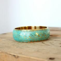 """Gorgeous 1"""" wide brass bangle has been given a turquoise patina and sealed. Great piece to add a little country chic glam to any outfit. Wear with a little black dress or jeans and  your favorite T."""