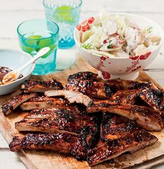 A recipe for sticky pork ribs with potato salad by Abigail Donnelly. Braai Recipes, Pork Recipes, Cooking Recipes, Recipies, Baked Ribs, Baked Pork Chops, South African Recipes, Indian Food Recipes, Green Chili Pork Stew